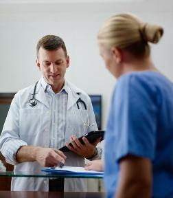 Doctor meeting with nurse