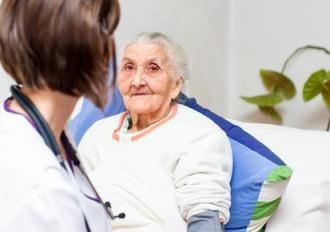 home care nurse with patient