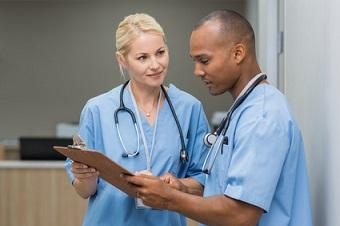 Nurse helping to educate coworker
