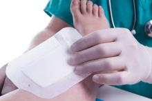 Nurse Removing Adhesive Bandage to Prevent MARSI